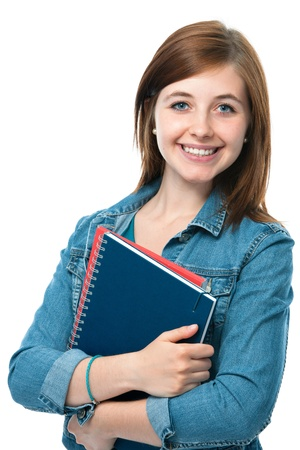 charming young student girl holding exercise books